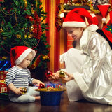 Mother and Baby Near Christmas Three Royalty Free Stock Image
