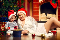 Mother and Baby Near Christmas Three Royalty Free Stock Photos
