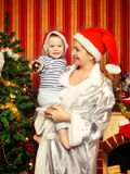 Mother and Baby Near Christmas Three Stock Photos