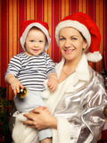 Mother and Baby Near Christmas Three Stock Image