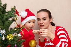 Mother with baby near the Christmas tree Stock Photo