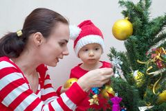 Mother with baby near the Christmas tree Royalty Free Stock Photo