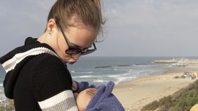Mother and baby near the coastline of mediterrian stock footage