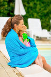 Mother and baby near swimming pool Stock Photos