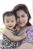 Mother and baby  with nice face happiness emotion Stock Photography