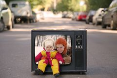 Mother and baby are in old television set Stock Images