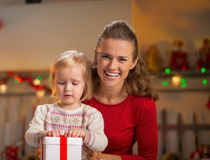 Mother and baby opening christmas present box Royalty Free Stock Photography