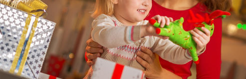 Mother and baby opening christmas presents Royalty Free Stock Photography