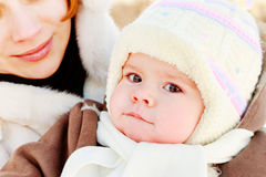 Mother with baby outdoor. Woman with baby on her hand in winter Royalty Free Stock Photo