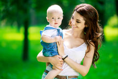 Mother and baby outdoor Stock Images