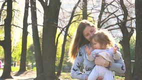 Mother with baby outdoor stock video footage