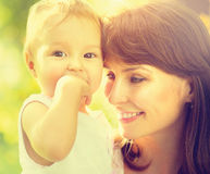 Mother and baby outdoors Royalty Free Stock Photos
