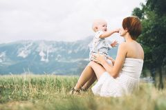 Mother and baby outdoors. Family on nature stock images