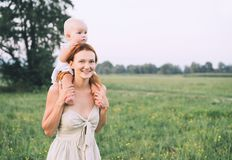 Mother and baby outdoors. Family on nature royalty free stock image