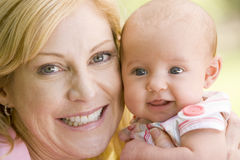 Mother and baby outdoors smiling Royalty Free Stock Photos