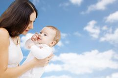 Mother with baby over sky background stock photography
