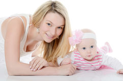 The mother with baby over white. The happy mother with baby over white Stock Photos