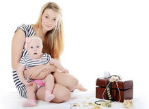 The mother with baby over white. The happy mother with baby over white Stock Photo