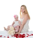 The mother with baby over white. The happy mother with baby over white Royalty Free Stock Images