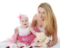 The mother with baby over white. The happy mother with baby over white Stock Photography