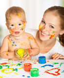 Mother and baby paint colors hands dirty Royalty Free Stock Photo