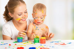 Mother and baby paint colors hands dirty royalty free stock photography