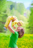 Mother with baby in the park. Mother with baby playing in the park royalty free stock images