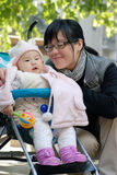 Mother and baby in the park. Chinese mother and baby in the park Royalty Free Stock Photo