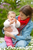 Mother with baby in the park. Mother with baby playing in the park Stock Photo