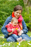 Mother with baby in the park. Mother with baby playing in the park Stock Photos