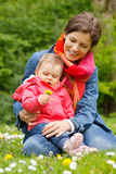 Mother with baby in the park. Mother with baby playing in the park Stock Photography