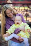 Mother with baby in park Royalty Free Stock Photography