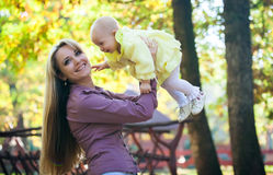 Mother with baby in park Stock Photo