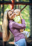 Mother with baby in park Royalty Free Stock Image