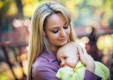 Mother with baby in park Stock Images