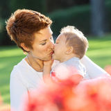 Mother and baby kiss stock photos