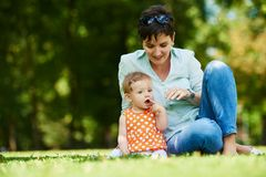 Mother and baby in park Royalty Free Stock Images