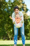 Mother and baby in park Royalty Free Stock Photos