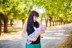 Mother and baby in park Stock Image