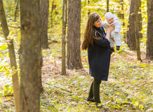 Mother and baby in park portrait Stock Photo