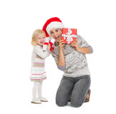 Mother and baby peekaboo from Christmas present Stock Image