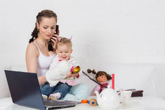 Mother and baby with phone. Stock Photos