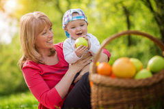 Mother and baby on a picnic stock photography