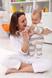 Mother and baby playing Stock Photos