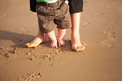 Mother and baby playing on the beach Royalty Free Stock Photography