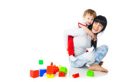 Mother and baby playing with building blocks toy. On white stock image