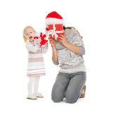 Mother and baby playing with Christmas present Royalty Free Stock Image