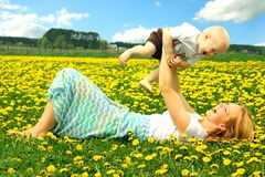 Mother and Baby Playing in Field Stock Photography