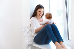Mother and Baby playing. Happy Family stock photos