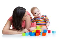 Mother and baby playing and having fun royalty free stock photo